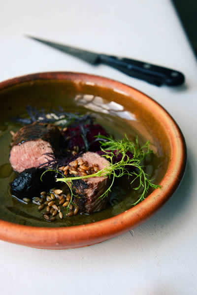 Saddle of goat with fermented garlic, spelt and beetroot